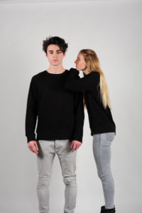 Man and woman wearing black Fairtrade cotton sweatshirts
